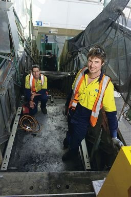 Roman Egli and Steve Percy working on the escalator upgrade at Warwick train station.www.communitypix.com.au d406577