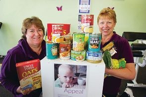 Nola McLean (Heathridge Curves, left) and Brenda MacDougall (Kinroos Curves) with food donated by clients for Food Bank Winter Appeal. Picture: Emma Reeves www.communitypix.com.au d406720