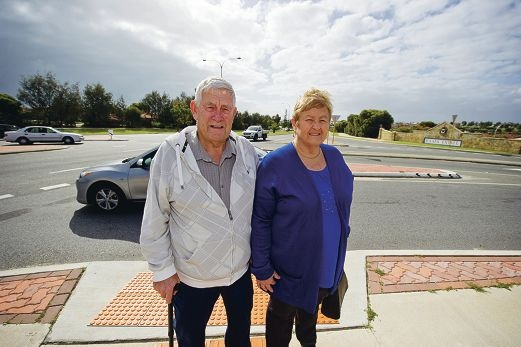 Maitland and Lorraine Briggs are local residents who are signing a petition to get traffic lights at the intersection, it is difficult to get onto Marmion Ave around school times and close of business