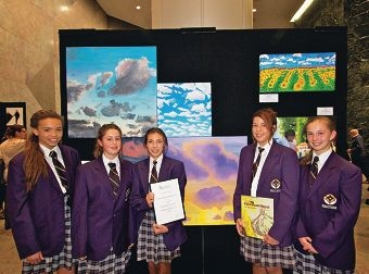 Lucie Nisbett, Emma Crowhurst, Ashleigh Vahala, Danielle Vahala and Danielle Tredoux with some of the artwork.