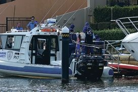 Police investigate the discovery of a dead body in a Halls Head canal last week.