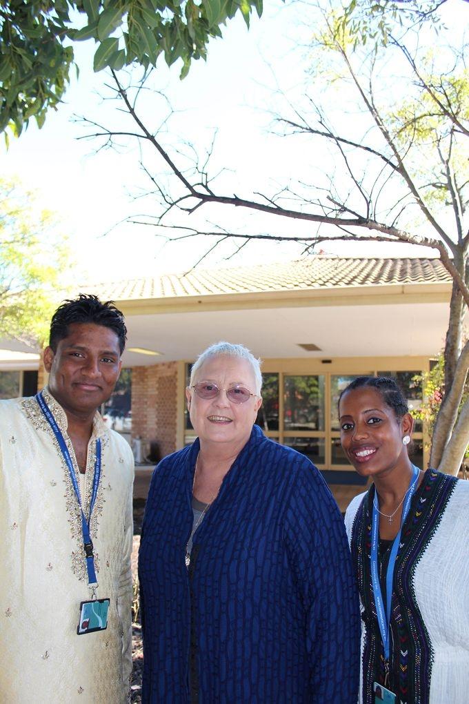 Communicare Humanitarian Settlement Services' arrivals team leader Sam Kugathas, Communicare chief executive Martine Pitt and case manager Fana Alem.
