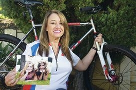Help Corina Gorton raise $5000 for cancer research on 0402 675 300. She is holding a picture of her daughters. d406444