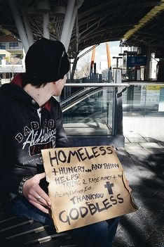Andrew outside Subiaco railway station with his sign. Picture: Rosanna Candler