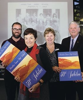 Hamilton high school teachers Glenn Carpenter,Valerie House, principal Donna McDonald and Cockburn Mayor Logan Howlett with the archive books. Picture: Martin Kennealey d406324