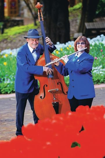 Peter Massey, of Roleystone, and Sally Girling, of Mt Nasura, will play among the colourful displays of Araluen's tulips. Picture: Marcelo Palacios d406449