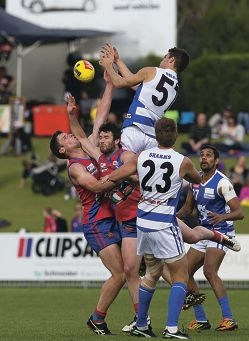East Fremantle's Alex Howson crashes a pack. Pictures: Dan White