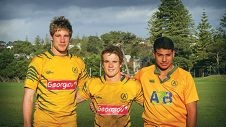 Kyle Godwin with current Associates players Kylan Yoxall and Thomas Masibaka.