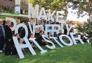 Local Oxfam campaigners make their |message clear in support of the petition.