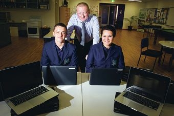 Laptop win: Year 12 student Brad Lampitt with head of technology John Keyworth and head girl Malia Hunt from Clarkson High School. www.communitypix.com.au d406088