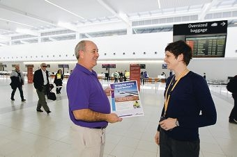Ron Giblett, from the AEC, with airport customer service supervisor Samantha Ellis.