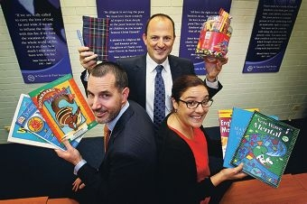 Ernst and Young's Bryan Cooke, St Vincent de Paul Society CEO Mark Fitzpatrick and manager Rebecca Callaghan browse some homework material. Picture: David Baylis d406021