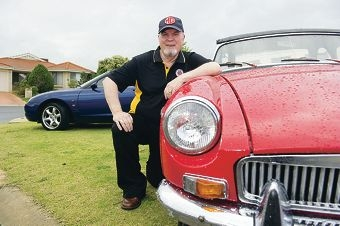 MG Car Club of WA captain Iain Trainor with his beloved red sports car. Picture: Emma Reeves www.communitypix.com.au d406089