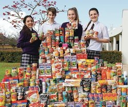 Sarah Bellew, Heath Clark, Olivia Taylor and Ellie Emmett with some of the donated goods.