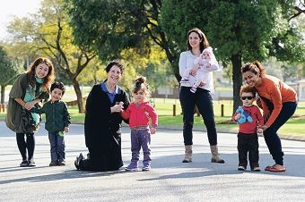 Italian Australian Child Care Centre manager Assunta Martella with Zara Agapitos (centre) and, from left, Mary Kim with her son Daniel, Sofia Agapitos with her daughter Savanna and Brigitte Legeron with her son Alexandre. Picture: Marcus Whisson d406085