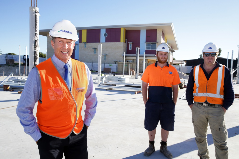 Principal Cameron Herbert with former students, brother Kiel and Martin Tilley, who are members of the team building the new academic centre. Picture: Martin Kennealey        www.communitypix.com.au   d453973