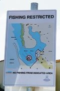Signs indicate where fishing is not allowed around the marina.