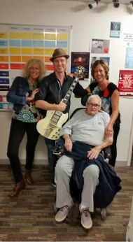Sue Myc, musician Matty T Wall and Nina Henderson celebrate with David Apps.
