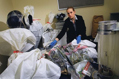 Senior Constable Detective Sacha Howlett from Armadale Police Station with the drugs and hydroponic equipment that were seized from a Mt Nasura property. Picture: Marcelo Palacios www.communitypix.com.au d405571