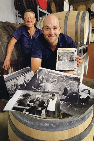 Ian and Anthony Yurisich with old photos and news clippings relating to Olive Farm Wines. Picture: Bruce Hunt www.communitypix.com.au d405471