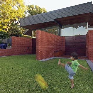 Aleksander Podias (5) kicks a ball in the back yard of his Coolbinia home.