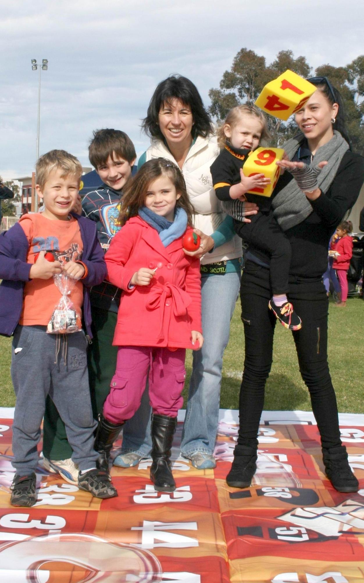 Crystal Quartermaine holds her baby Ahlaira Collard beside Mitch, Jack, Ella and Tash Binns.