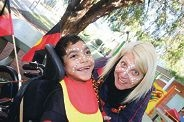 Alfie in his face-paint and outfit made in Aboriginal colours by Neata Gear. Below: Sammi displays his face paint.