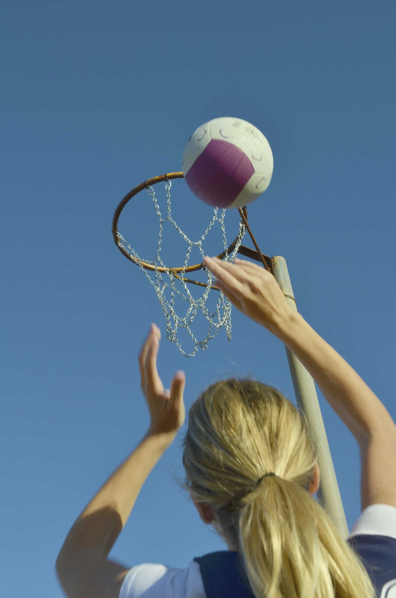 Parents have complained about the slippery surface of the new netball courts.