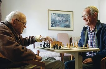 Real mates...Volunteer Craig Johns and Braemar Village resident Brian Morcombe play chess regularly and have become firm friends.