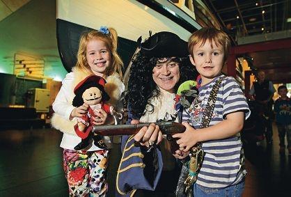 LtoR: Mia Clarke (6), Maritime Museum director Ian MacLeod and Kai Sinclair (4).