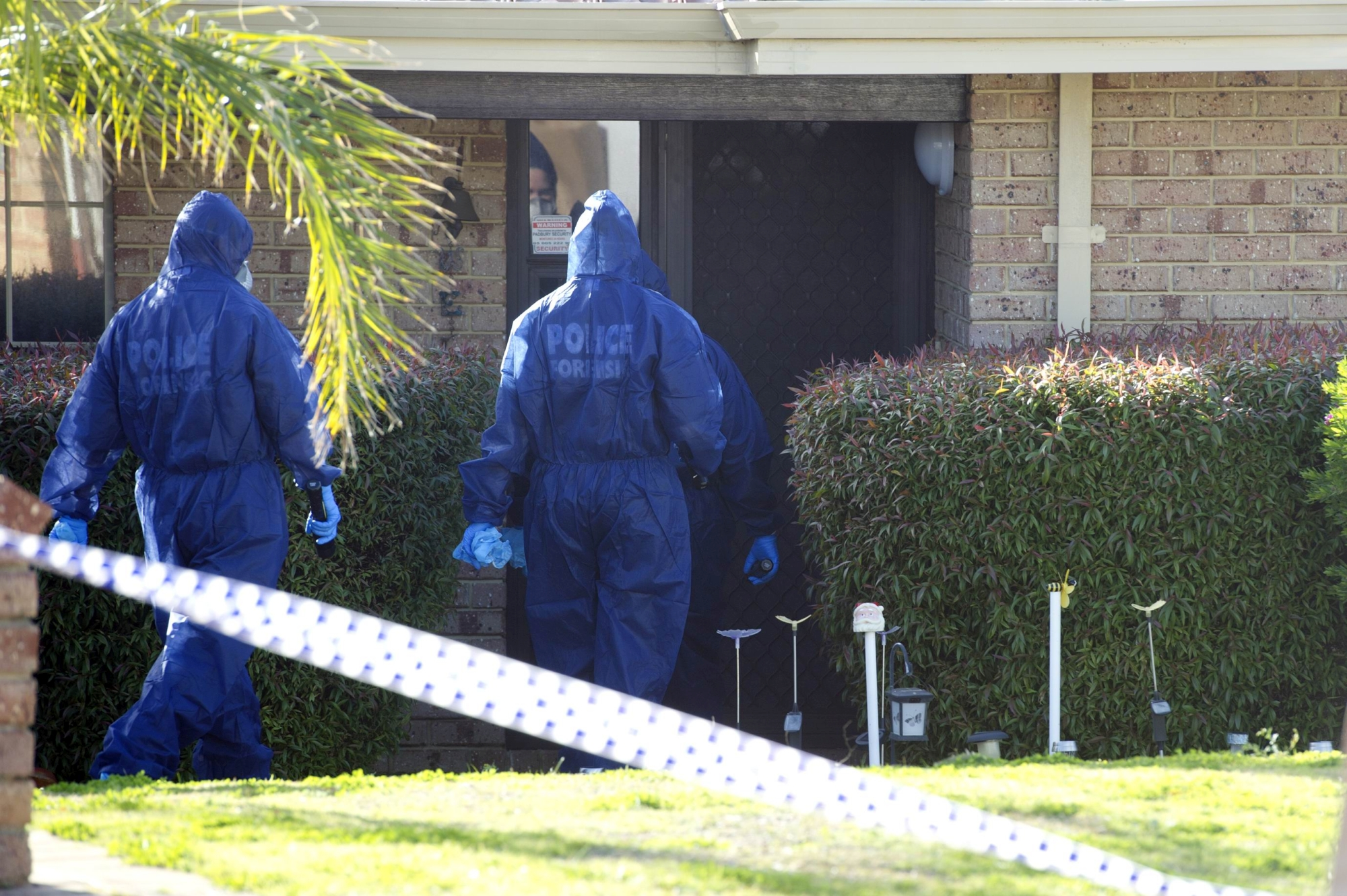 Police officers at the Padbury house where two bodies were found yesterday. Picture: Emma Reeves www.communitypix.com.au d404934