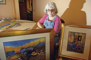 Judith Jordan prepares for the Army Art exhibition next month.