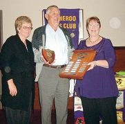 Outgoing president Elizabeth Valeriani (right) presents Citizen of the Year to John Miller.