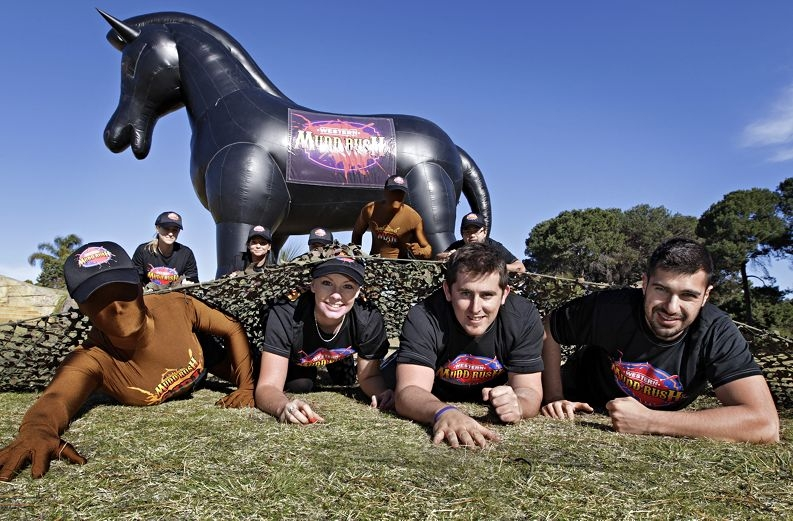 Mudd Rush and City to Surf entrants Courtney Adams, Trevor Hickey and Domenic Chiellini with Summit employees in the background. Picture: Elle Borgward d404757b