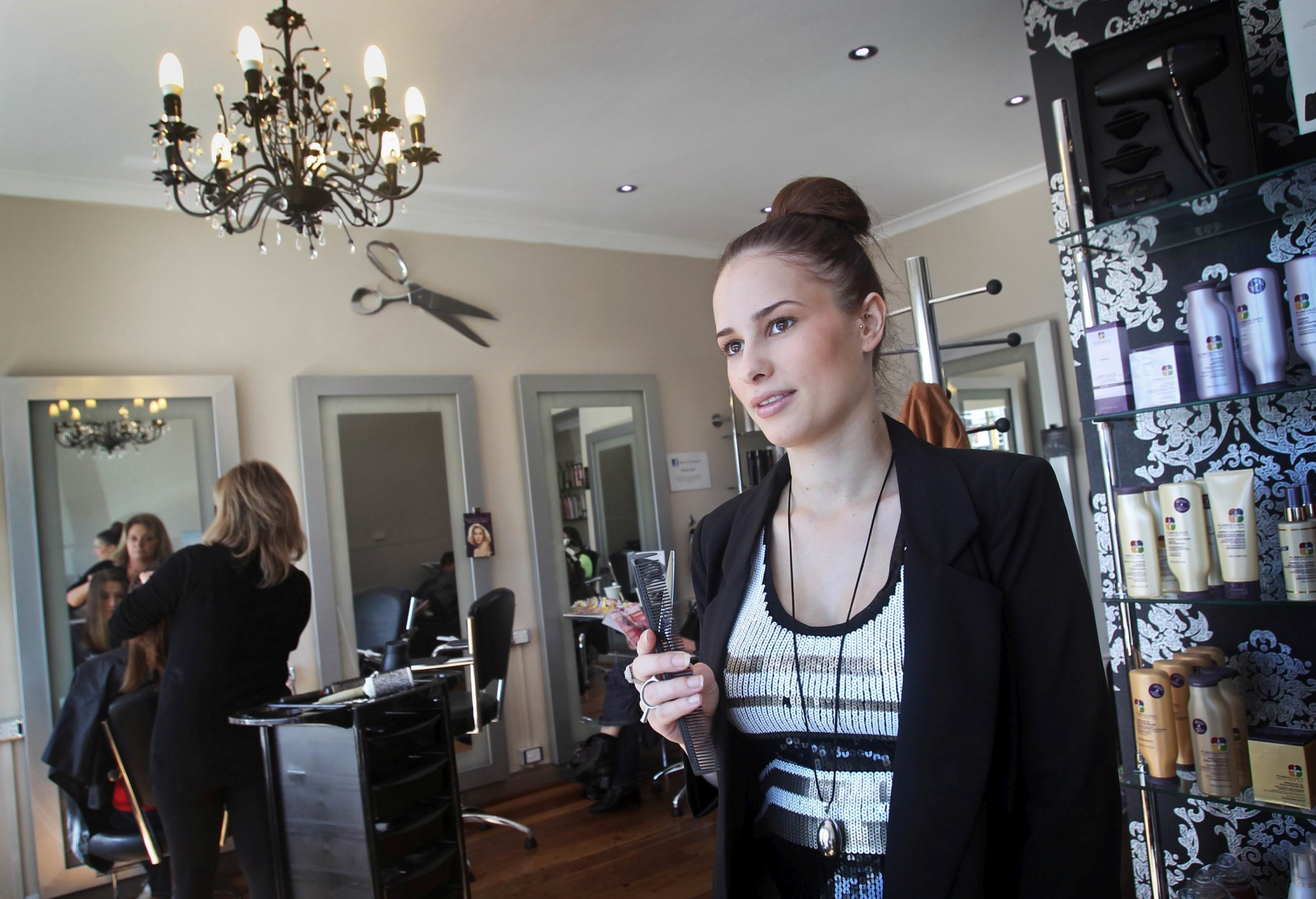 Selina Bello at work inside the salon she ran with her late mother Angela Ferullo.Picture: David Baylis d404566