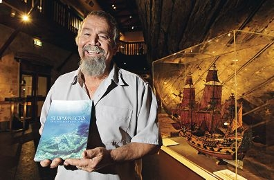 Michael McCarthy with his book with his book about the history of shipwrecks.