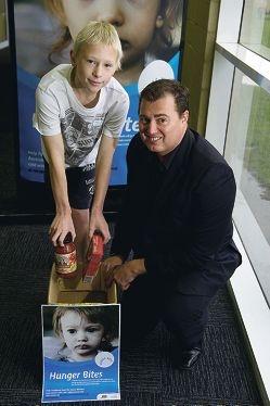 Jayden Downes with Arena Joondalup Director of Venue Services Chris Andrich.