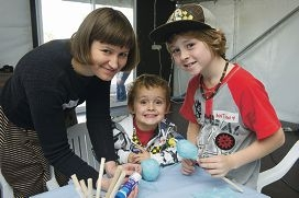 Artist Renae Coles with Jamie (4)and Anthony Lacy (9) at one of the