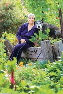 Organic gardener Lisa Porter, of Bedfordale, with her dog Grace. Picture: Marcelo Palacios d404172