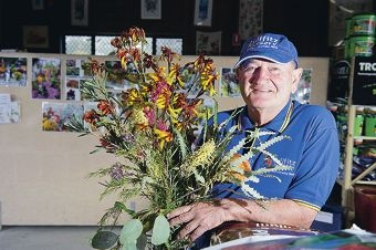 George Lullfitz prepares for his winter flower display.