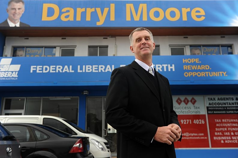 Darryl Moore with his campaign poster.