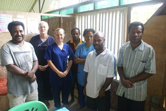 St John of God Murdoch Hospital emergency nurse Jodie Thompson with local women in Papua New Guinea.