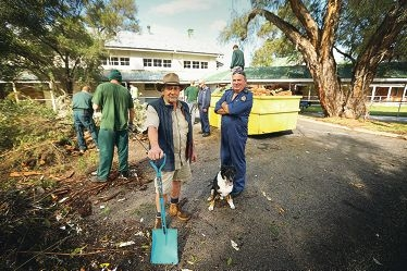 Caretaker Russell Merson with his dog Merri and Vocational Support Officer Peter Smithers while work progresses.