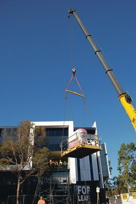 The new medical equipment being hoisted into the building.