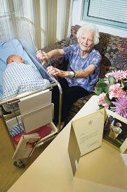 Centenarian Lavinia Jeffries with newborn Fraser Steicke. Picture: Emma Reeves d405132