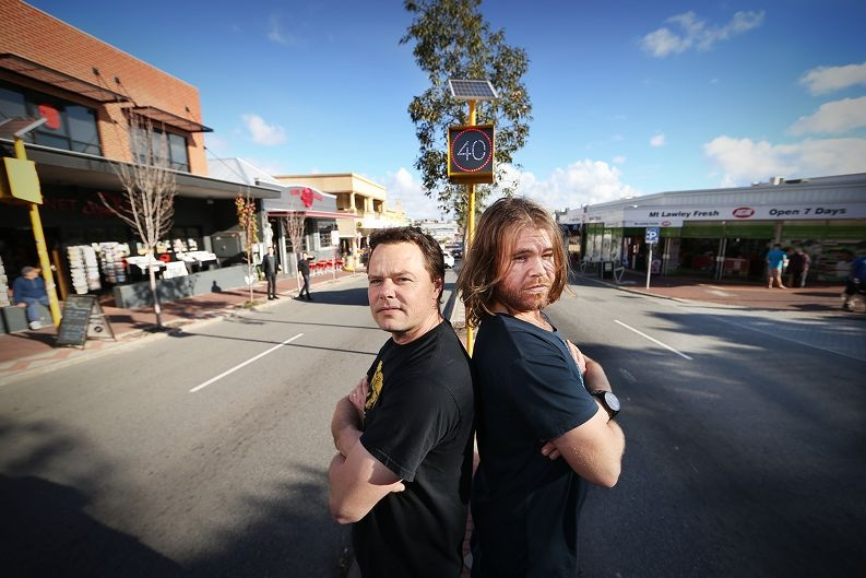 Scott Jones from Planet Video and Zak Vivian from The Flying Scotsman highlight the divide between Perth and Stirling, which is the middle of Beaufort Street. Picture: Andrew Ritchie www.communitypix.com.au d405386