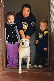 Kylee Hastee with dog Jade and children Jameelee and Braedon Plummer. Picture: Marcelo Palacios d404219