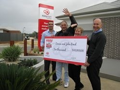 John and Denise Bond ( centre) celebrate their win with Easystart Homes' Colin Giuffre and Chris Hopkin.