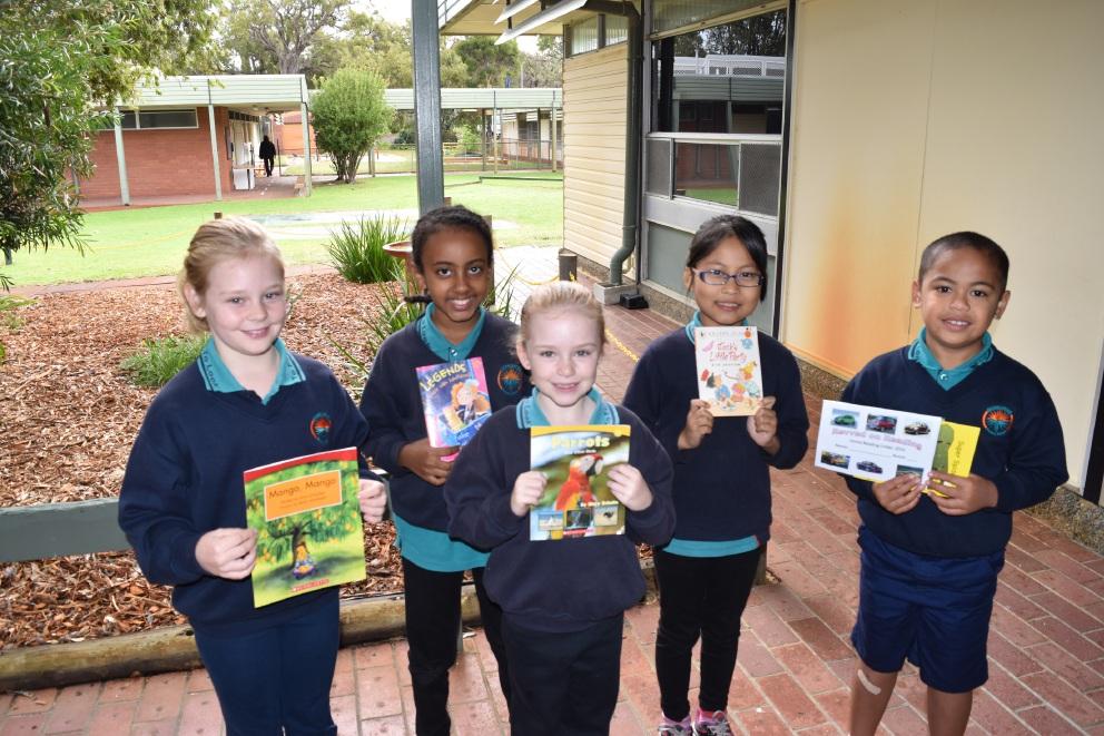 Joyful readers: Warriapendi Primary School students Georgia Dersio, Elizabeth Dinku, Tayah Dersio, Pawthasue Htoo and Lucas Ioapo are in the school's reading program.