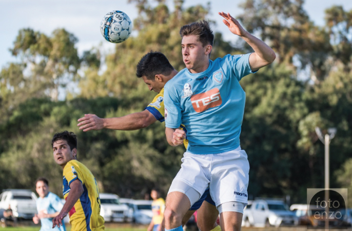 Perth Soccer Club's Matthew Milenkovic challenging Inglewood United's Jason Colli. Picture: Vince Caratozzolo